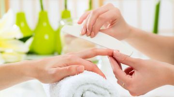 bigstock-Woman-in-a-nail-salon-receivin-51176980